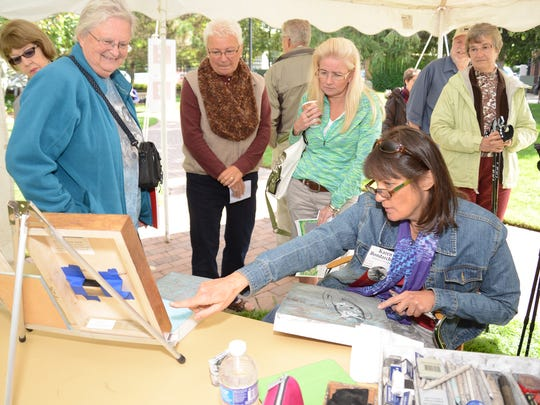 "Karen Bondarchuk participates in Artists in Action during the 2015 ""Birds in Art"" opening weekend festivities at the Leigh Yawkey Woodson Art Museum in Wausau."