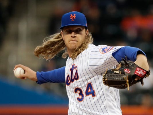 FILE - In this Thursday, April 20, 2017 file photo, New York Mets' Noah Syndergaard delivers a pitch during the first inning of a baseball game against the Philadelphia Phillies in New York. The Mets plan to have ace Noah Syndergaard make a one-inning start Saturday, Sept. 23, 2017 in his first major league game in nearly five months. (AP Photo/Frank Franklin II, File)