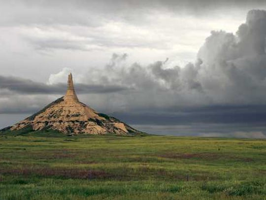 Chimney Rock in Nebraska with storm clouds in the distance