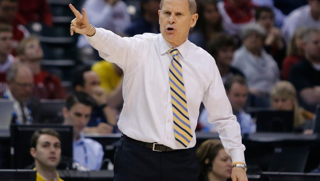 Michigan basketball coach John Beilein directs his team against Indiana in the quarterfinals of the Big Ten tournament March 11, 2016, in Indianapolis.