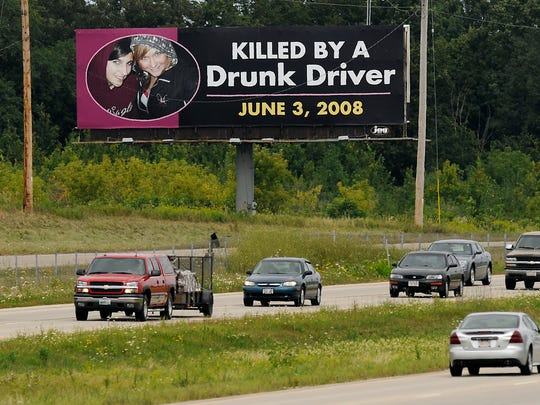 A billboard along U.S. 41 near Wrightstown in 2008 shows Ashley Britsch-Knetzger and Talhia Heroux, both 18, who were killed in a crash in Ashwaubenon. The Ledgeview woman who slammed into their car was was convicted of two counts of first-degree reckless homicide and one of recklessly endangering safety.