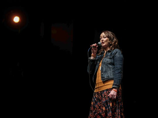 Sarah Turnbull shares a story about her daughter at the Des Moines Storyteller's project at the Des Moines Playhouse on Tuesday, Feb. 6, 2018.