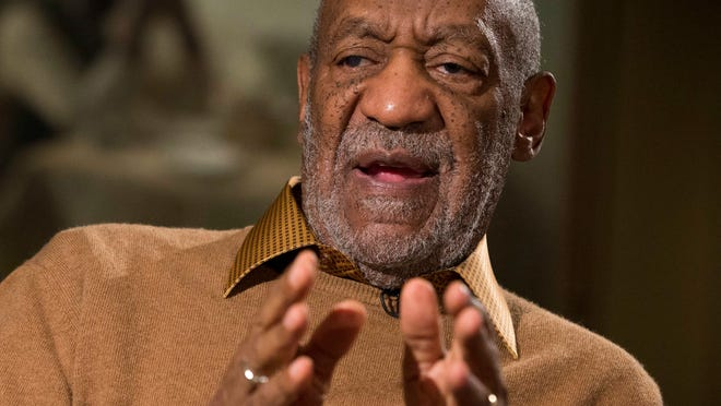 In this Nov. 6, 2014 file photo, entertainer Bill Cosby gestures during an interview about an exhibit at the Smithsonian's National Museum of African Art, in Washington. The writer addresses a past letter about accusations that Cosby sexually abused several women. Cosby's lawyer has written in a court filing that an allegation dating to 1974 was an attempted extortion.