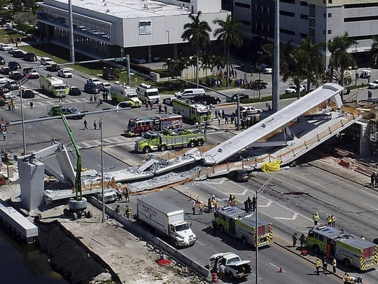 Emergency personnel respond after a brand-new pedestrian bridge collapsed onto a highway at Florida International University in Miami on March 15, 2018.