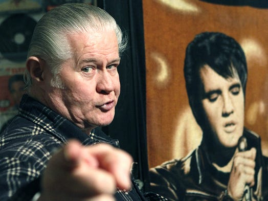 "In this Dec. 9, 2009 photograph, Paul MacLeod is a perpetually caffeinated Elvis fanatic who's taking care of business 24-7-365 at the antebellum home he calls ""Graceland Too,"" in Holly Springs, Miss. (AP Photo/Rogelio V. Solis) In this Dec. 9, 2009 photograph, Paul MacLeod is a perpetually caffeinated Elvis fanatic who's taking care of business 24-7-365 at the antebellum home he calls ""Graceland Too,"" in Holly Springs, Miss."