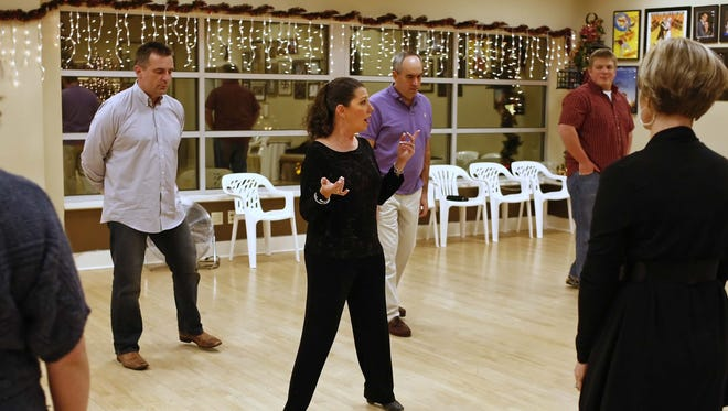 Lora LaMon (center) leads a class in Night Club Two Step at RJ Dance Studio in 2011.