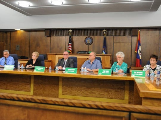 Garden City Council members and city staff listen to