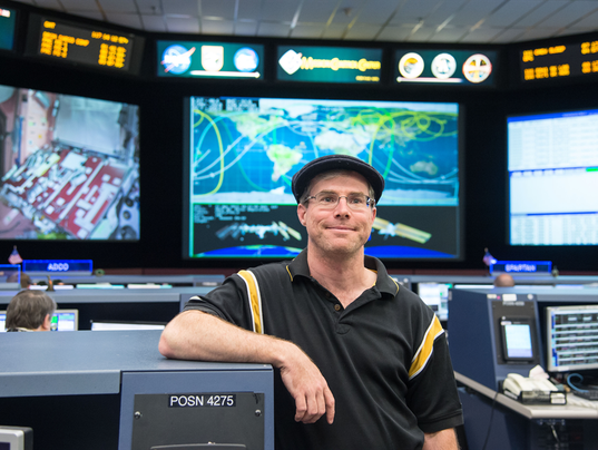 636459353222929845-Andy-Weir-in-the-MCC-during-his-tour-of-JSC.-Image-Credit-NASA-James-Blair-and-Lauren-Harnett---Copy.png