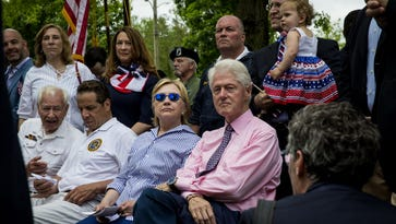 Hillary and Bill Clinton attend a Memorial Day ceremony  in Chappaqua on May 30, 2016.