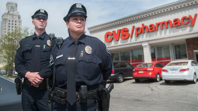 Camden County Police Officer Joseph McGrath and Camden County Police Officer Belinda Villegas-Ramos rescued a crying baby locked inside a vehicle parked at the CVS located on Mickle Blvd. in Camden on Thursday. 04.30.15