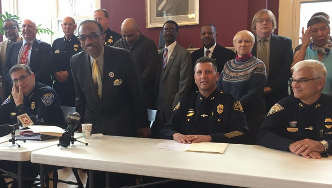 The Rev. Lewis Stewart opens a news conference to announce a new police-clergy collaboration. In the foreground, from left, are Rochester Police Chief Michael Ciminelli, Brighton Police Chief Mark Henderson and Irondequoit Police Chief Richard  Tantalo.