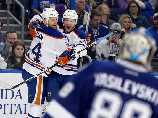 Edmonton Oilers right wing Zack Kassian (44) celebrates with right wing Iiro Pakarinen (26), of Finland, after scoring past Tampa Bay Lightning goalie Andrei Vasilevskiy (88), of Russia, during the first period of an NHL hockey game Tuesday, Jan. 19, 2016, in Tampa, Fla. (AP Photo/Chris O'Meara)