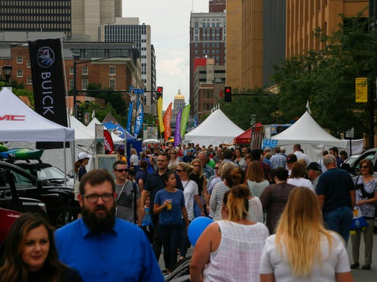 Thousands attend the Des Moines Arts Festival in the Western Gateway Park Friday, June 22, 2018.