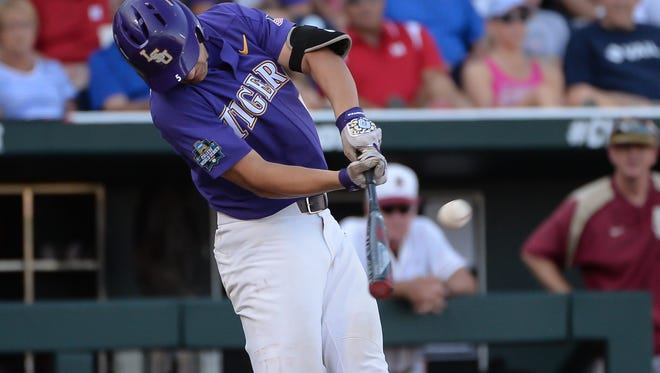 Jun 21, 2017; Omaha, NE, USA; LSU Tigers infielder Jake Slaughter (5) hits a home run in the second inning against the Florida State Seminoles at TD Ameritrade Park Omaha. Mandatory Credit: Steven Branscombe-USA TODAY Sports