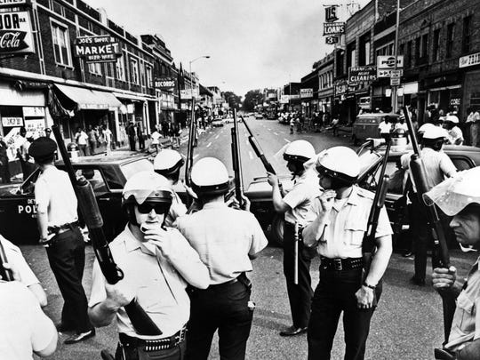 Police blockade a street on Detroit's Near West Side, about three miles from the downtown area on July 23, 1967 during the riot.