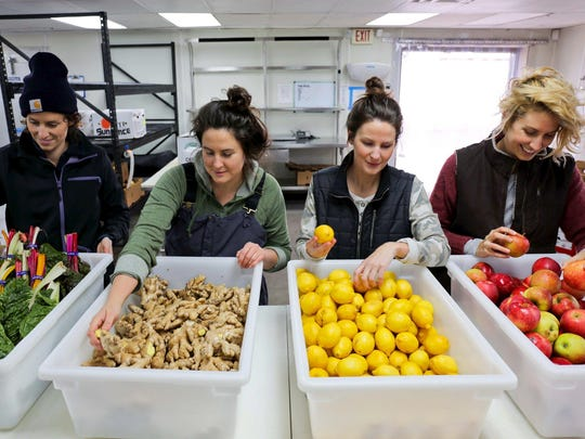 The sisters wear gear by Dearborn-based Carhartt at their Ferndale production facility for Drought organic juices. Jessie James, left, Jenny James, Julie James and Caitlin James.