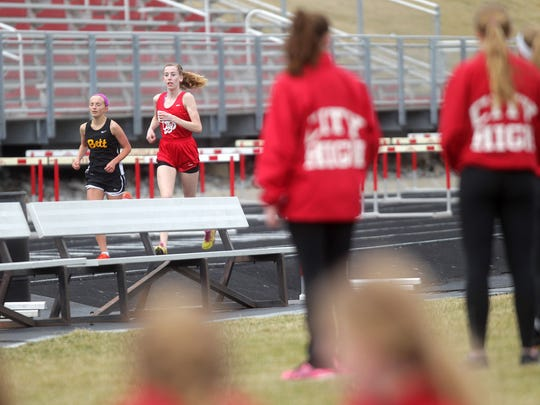 City High's Mary Arch competes in the 3,000 meter race