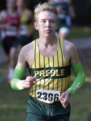 Green Bay Preble senior Nick Petersen, shown during the cross-country season last year, won the 3,200-meter run last Thursday at the Indoor City Track and Field Meet.
