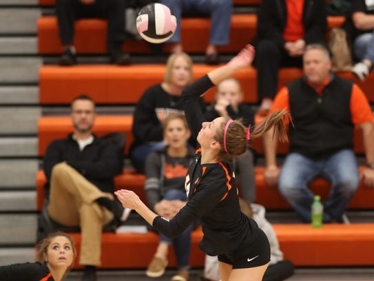 Valley's Madi Kubik goes for the kill against Southeast Polk in a 2016 match. Reese Strickland/For the Register