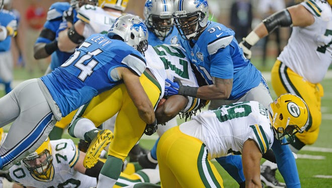 Green Bay Packers running back Eddie Lacy (27) gets tackled in the end zone for a safety by DeAndre Levy (54) and Jason Jones (91) against the Detroit Lions at Ford Field in Detroit September 21, 2014.  Jim Matthews/Press-Gazette Media