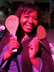Vickie Marshall shows the Golden  Paddles sold for