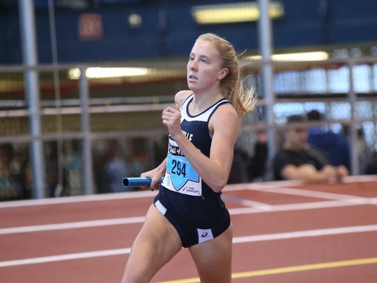 Bronxville's Laura Holland runs a leg of the 4x800-meter