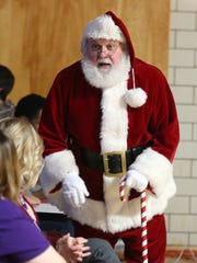 Santa Claus attends a talent show Dec. 3, 2014, at Youth Emergency Services & Shelter in Des Moines.