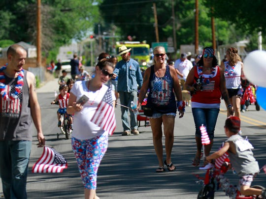 Parade participants walk along South First Street during Bloomfield's annual Fourth of July parade on Monday.