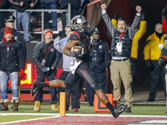 In this file photo Rutgers fans cheer as Rutgers wide receiver Leonte Carroo (4) scores touchdown against Indiana.