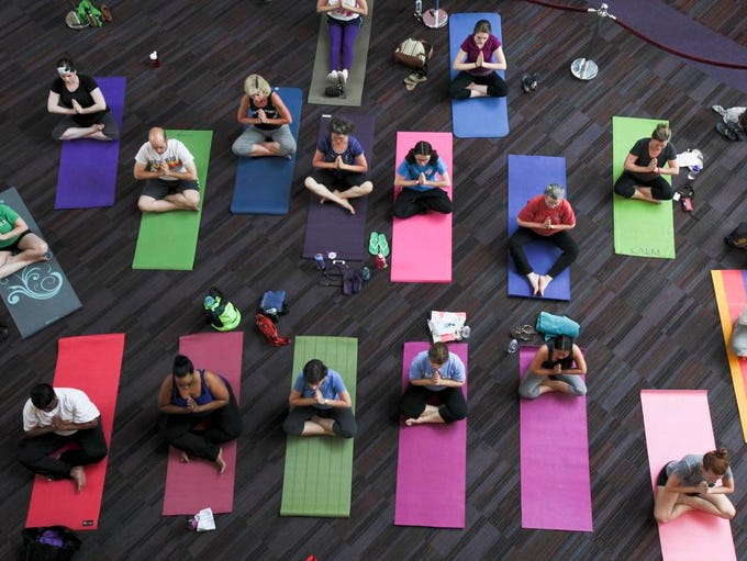 Jamie Calzi directs a yoga class at the Kentucky Center. June 13, 2014