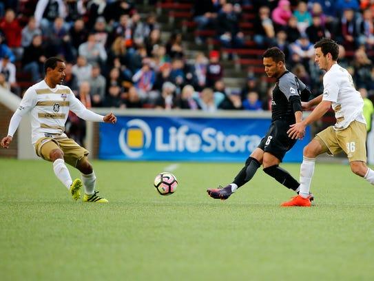 FC Cincinnati midfielder Kenney Walker (6) passes the