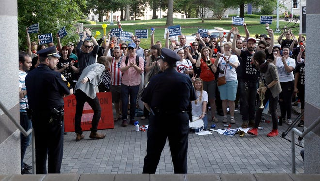 Protesters gather outside the the North Carolina Museum of History as Gov. Pat McCrory made remarks about House Bill 2 during a government affairs conference in Raleigh, N.C., on Wednesday.