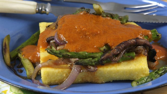 """Blue cheese polenta with asparagus and red pepper sauce is a """"most marvelous"""" appetizer at Cafe Lou Lou."""