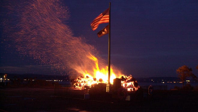 The Memorial Day watchfire burns at the end of the Piermont pier as dawn nears in this file photo.