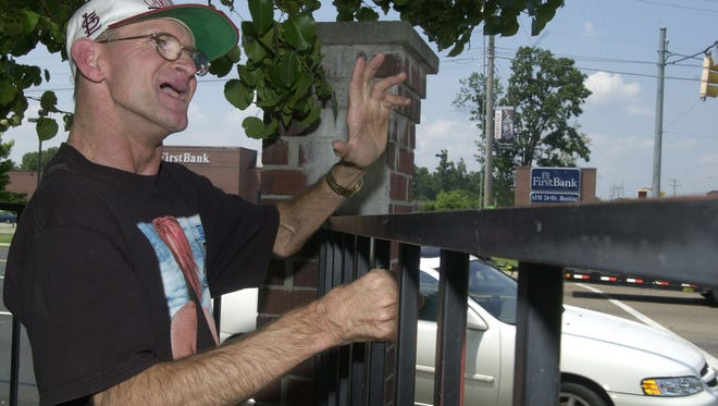 Tim Coats, a resident at Jackson Oaks, has been standing or sitting at the corner of University Parkway and Highland Avenue for nearly 20 years, waving at everyone who passes by.
