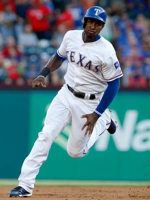 Texas Rangers left fielder Jurickson Profar (19) rounds second base in the first inning against the Kansas City Royals  at Globe Life Park in Arlington.