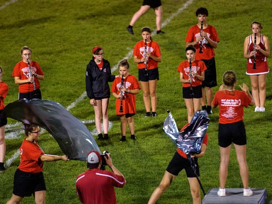 Freshman Autumn Michels, center, performs as part of the marching band as senior Rachael Steffens, center left, guides her during the band's performance at halftime of the homecoming football game on Friday, Sept. 22, 2017, at Laingsburg High School.