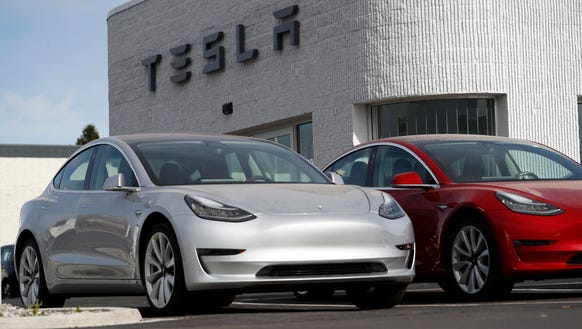 A Tesla Model 3 is seen April 15, 2018, in Littleton, Colo. It has a 220-mile range and starts at $35,000, according to Tesla.