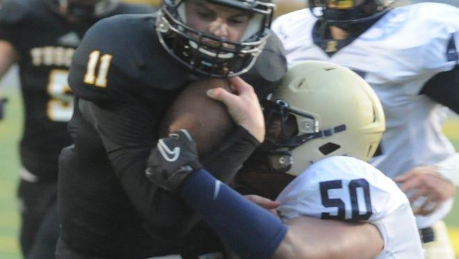 Tuscola graduate Woody Cornwell (11) is now a freshman football player at N.C. State.