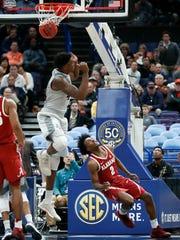Alabama's Collin Sexton (2) watches as he scores a