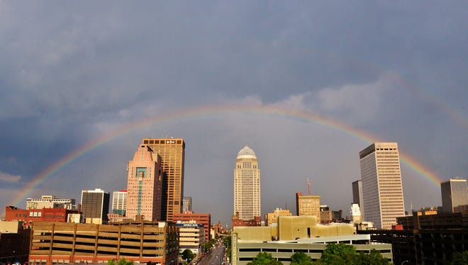 A rainbow arches over Louisville's downtown skyline after an afternoon storm. May 16, 2012