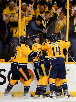 Predators players celebrate after center Mike Fisher (12) scored the game-winning goal during the third overtime period in Game 4.