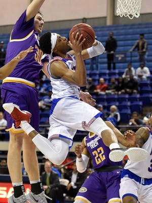 Tennessee State Tigers guard Tahjere McCall (5) shoots against the Tennessee Tech Golden Eagles during overtime at the Gentry Center in Nashville, Tenn., Thursday, Jan. 19, 2017.