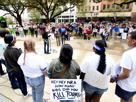 "Caddo Magnet Student, Jacqueline Bacud, wears a sign reading ""hey hey NRA how many kids did you kill today?"" during the March For Our Lives event Saturday, March 24, 2018, at the Caddo Parish Courthouse in Shreveport."