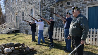 Robert DeBlasi of American Legion Post 344, right gives the command to his squad to fire the salute in front about 40  local residents, township officials, Boy and Girl Scouts, and American Legion members who attended the annual flag raising at the Ford-Faesch Manor House in Rockaway to remember the day in 1815 when miners from HMT, Hope Mine raised the flag to mark the end of the War of 1812.
