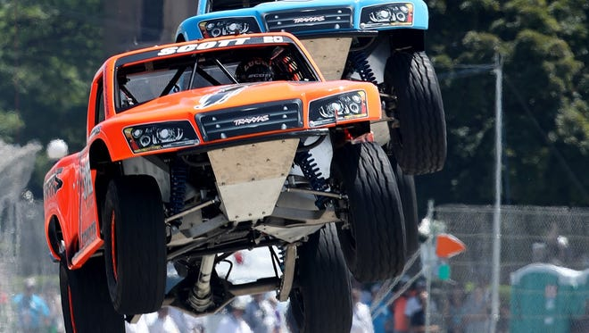 During the SPEED Energy Stadium SUPER Trucks Series Race 1, Dustin Scott jumps a ramp between turns 8 and 9 as EJ Viso comes in behind him. The popular truck race is one of two other support races at the Chevrolet Detroit Belle Isle Grand Prix in Detroit on Friday and through the race weekend.