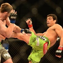Lyoto Machida (red gloves) fights against C.B. Dollaway (blue gloves) during UFC Fight Night at Jose Correa Arena.