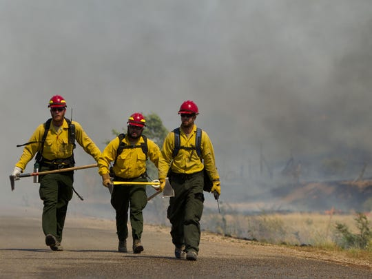 Multiple fire crews work to extinguish a wildfire in Leeds on  June 23, 2012.