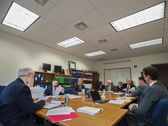 George Young of the Public Service Board, left, holds a hearing as part of an investigation of FairPoint quality of service issues in Montpelier on Tuesday. Also at the hearing were representatives of FairPoint and the Public Service Department.