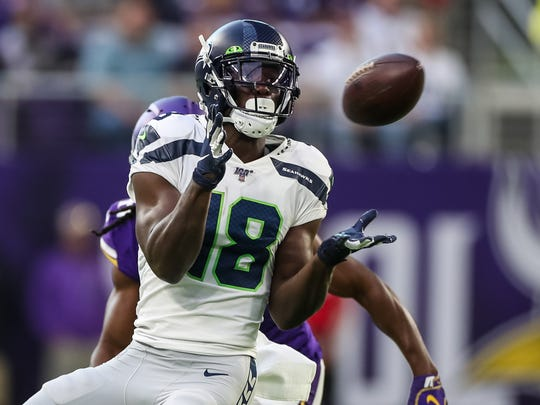 Aug 18, 2019; Minneapolis, MN, USA; Seattle Seahawks wide receiver Jaron Brown (18) catches a pass during the first quarter against Minnesota Vikings at U.S. Bank Stadium. Mandatory Credit: Brace Hemmelgarn-USA TODAY Sports
